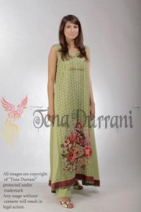 Lotus - Green Chikan with roses & Chinese handworked buttons by Tena Durrani